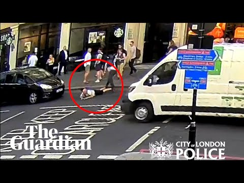 Man 'pushed' into traffic on busy London street