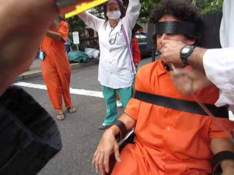 force-feeding simulation: guantanamo protest portland crosswalk