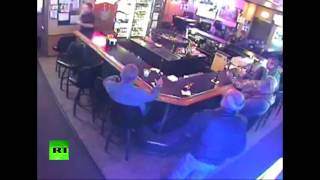 Love is blind: Kissing couple oblivious to armed robbery at Montana's bar
