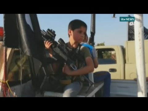 Children armed with rifles parade in ISIS convoy through Mosul