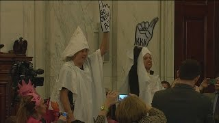 Protesters in KKK hoods are removed from confirmation hearing for Jeff Sessions