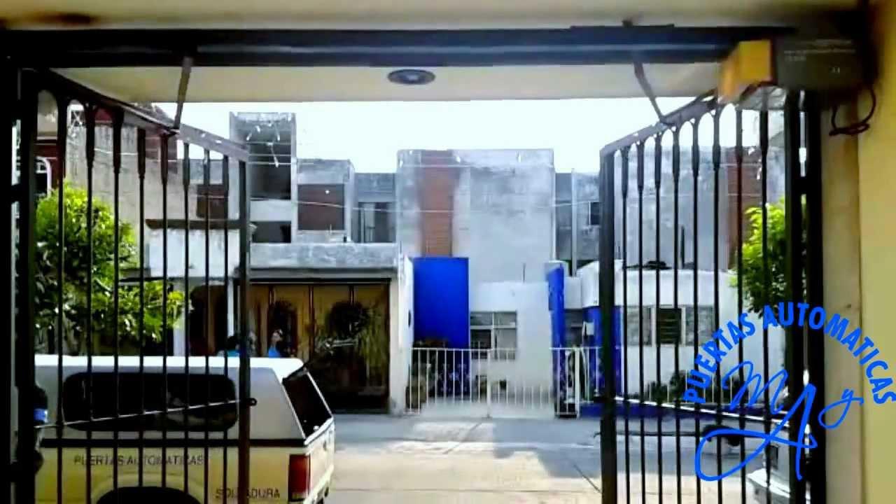 Puerta abatible con motor hacia afuera puertas for Puertas que abren hacia afuera