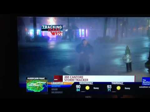 Jim Cantore Tebowing during Hurricane Isaac