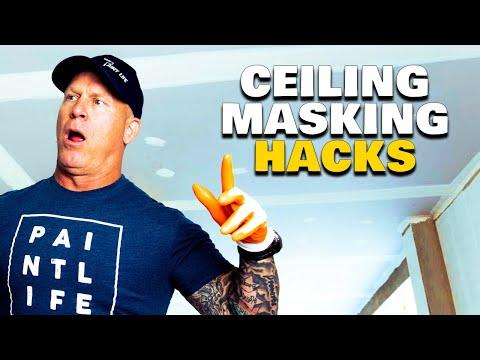 Masking A Ceiling. Using A Hand Masker Upside Down.