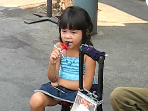 Little girl sings the blues in Bangkok