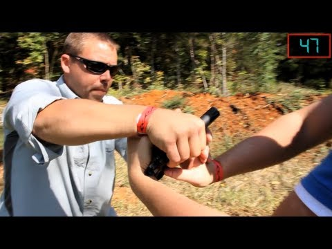 How To Disarm A Handgun Held With Both Hands | Tactical Minute