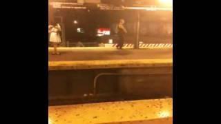 Dude dancing on the J platform