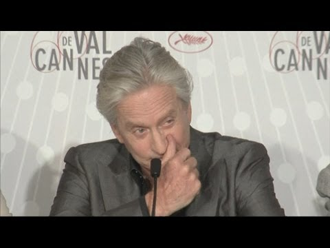 Michael Douglas cries at Cannes: Michael Douglas sheds a tear as he talks about his cancer