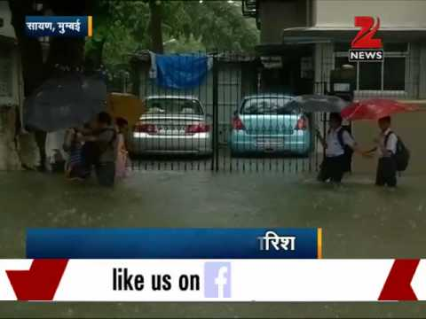 Heavy rains paralyse Mumbai; train services affected, schools closed