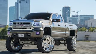 "One of the CLEANEST LIFTED trucks in Fort Worth! GMC with 26x14 American Forces on a 14"" Lift!"