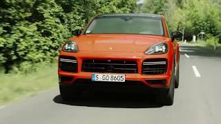 The new Porsche Cayenne Turbo Coupé in lava orange Driving Video