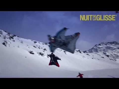 First ever wingsuit flying above skiers