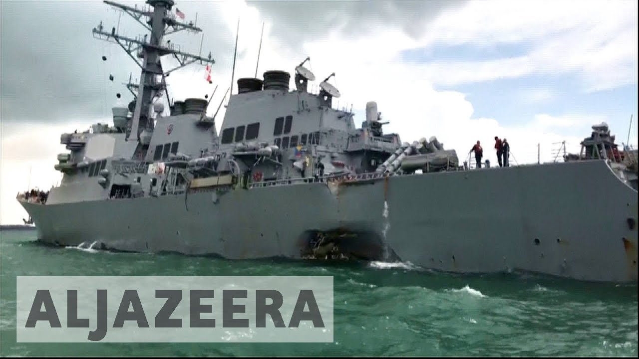 Sailors missing after US destroyer collides with oil tanker