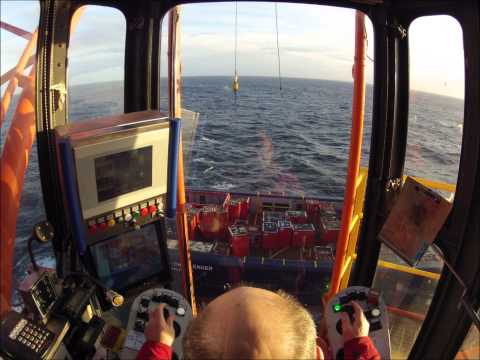 Working the crane on a North-sea rig.