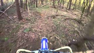 Backyard trail riding on a dirt bike