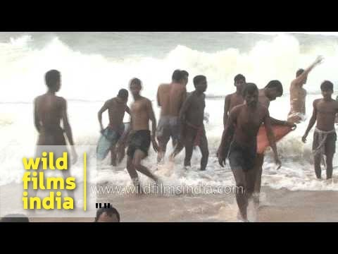 Waves hit the shore of Puri Beach - Odisha