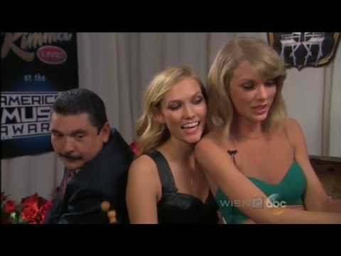 Taylor Swift and Karlie Kloss at behind AMAs 2014.