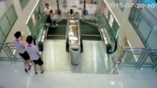 Mother killed in escalator incident