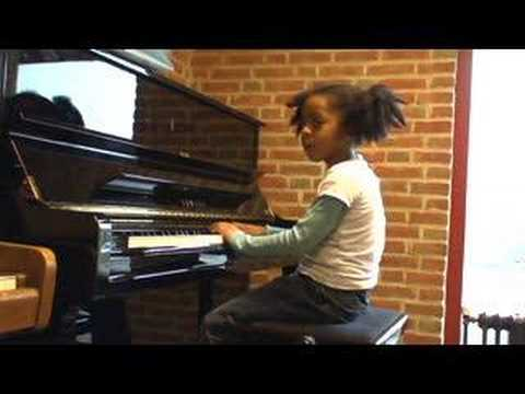 6yo girl learning how to play jazz funk piano 2006 teacher Michel Ristenpatt