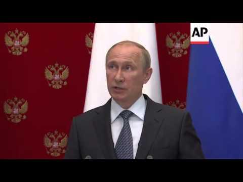 Putin urges Ukraine referendum delay in joint presser with Swiss president