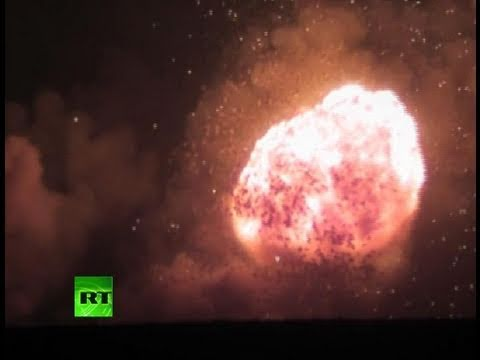 Stunning amateur videos of giant arms depot explosions in Russia