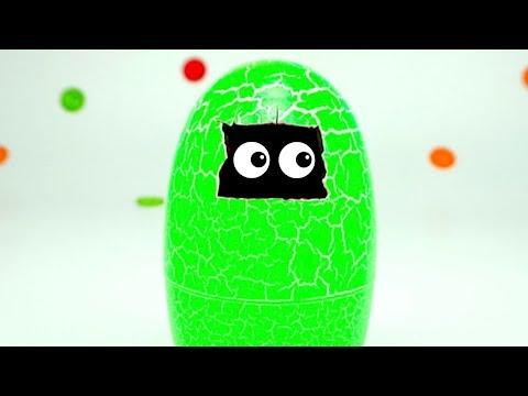 Распаковываем Игрушка Динозавр в яйце, наблюдаем как вылупляется