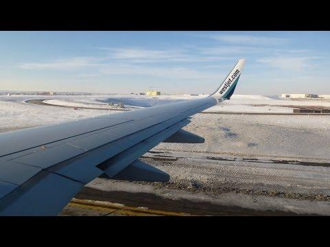 Westjet Boeing 737-700 C-GGWJ Departing Snowy Calgary Airport
