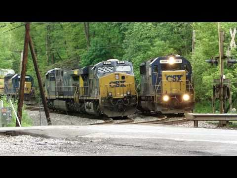 csx swaps engines around on the old main line due to a broken down engine on an auto rack at woodstock road, maryland, with lots of loud horns.