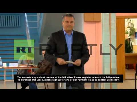 Ukraine: Aksyonov casts his vote calling it a