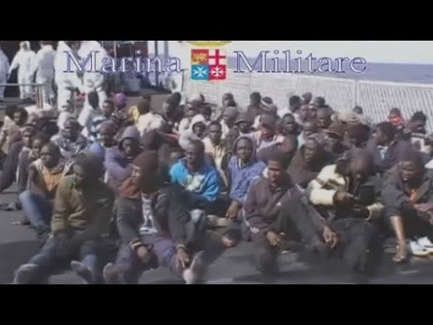 Migrants crammed into rafts rescued by Italian navy