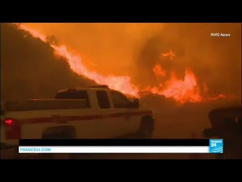 US: California wildfires triple in size and force thousands to flee their homes