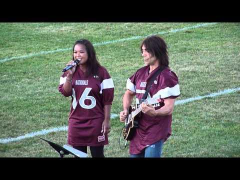 Beverley Wynne sings the anthem with Derek Gottfried on guitar