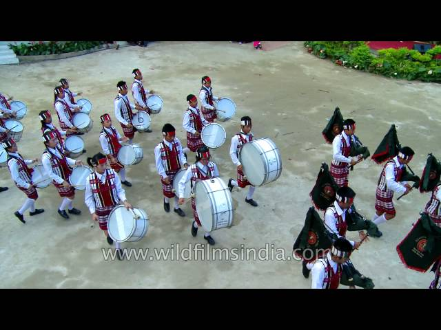 Perfect synchronization of footfalls and drum beats during a march by Mizo Pipers