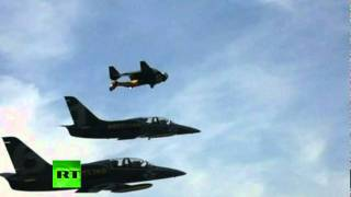 Amazing Video_ 'Jet Man' stunts alongside fighter jets over Alps