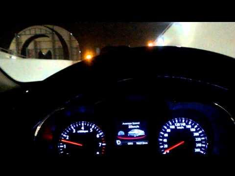 2011 KIA OPtima Drive in Dubai at night trying to park in mall