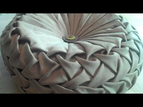 Canadian smocking/capitone round cushion by Debbie Shore. Matrix design.