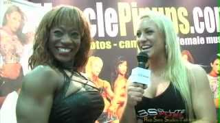 Female Bodybuilder Cassandra Floyd talks with fitness model Mary Schmitt at Arnold Classic 2012