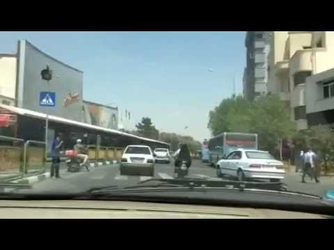 Downtown Tehran: drivers, motorcyclists and jaywalkers