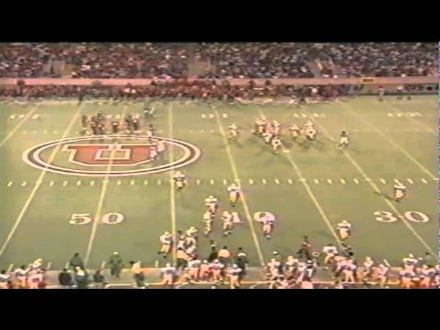 Utah punter Steve Young drops the snap and gets buried by the Ducks 9-21-1991