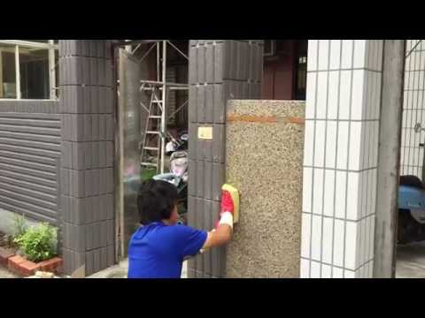 Cement rendering on outside brick wall with small stone ( pebble dash )