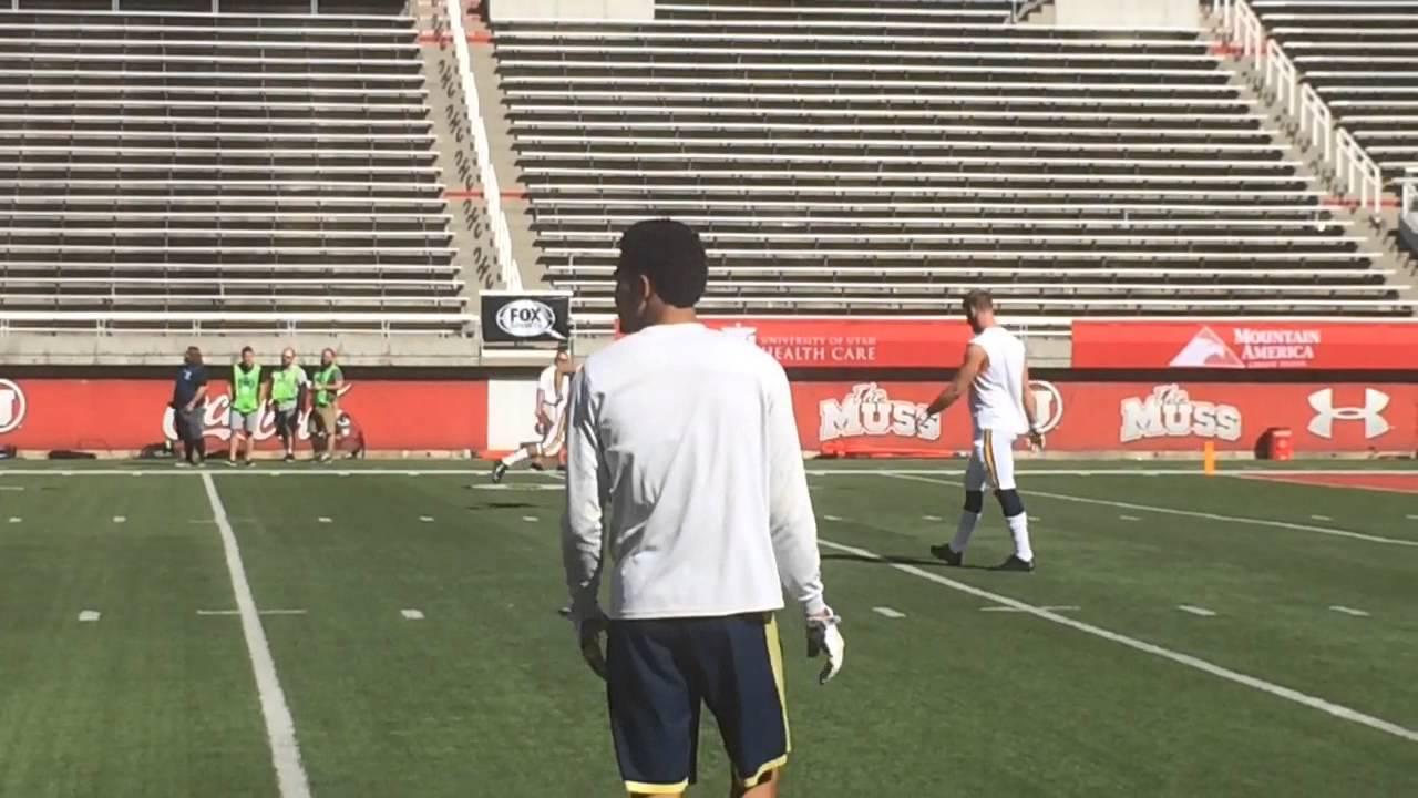 Michigan quarterbacks Jake Rudock and Shane Morris warmup prior to Utah game