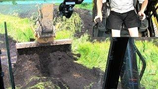 Cat 325D Excavator Swinging Topsoil: Dual Camera View