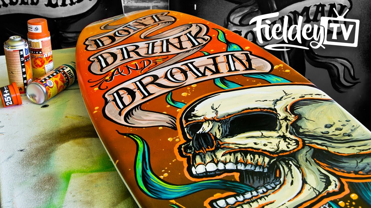 Painting a surfboard with a tattoo-style screaming skull