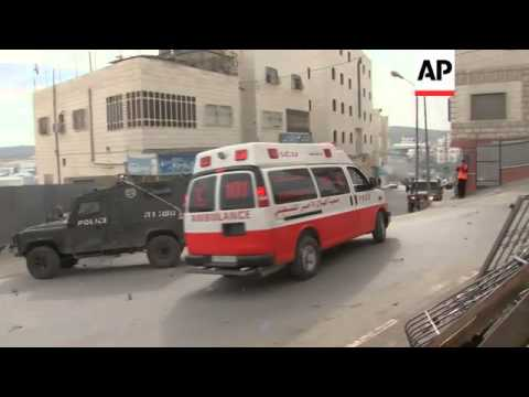 Clashes between Palestinians and israeli security in Hebron, Hamas anniversary rally in Gaza