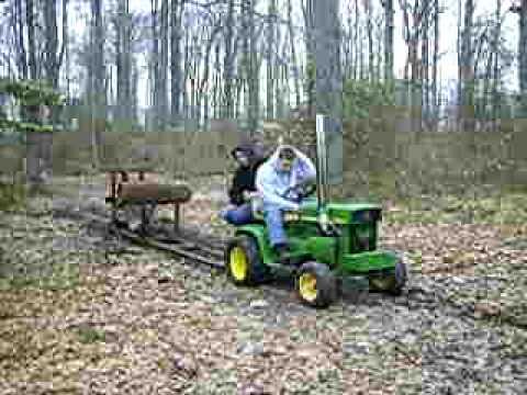 john deere 110 pulling sled