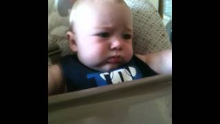 adorable baby eating oatmeal first time cute chubby fat funny laughing