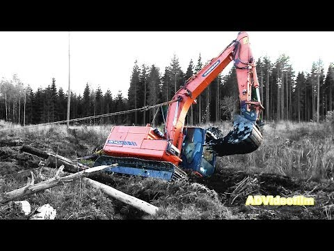 Doosan excavator is stuck in the mud 20 km South Gävle in Sweden. A job for Terribärgarn from �stervåla.