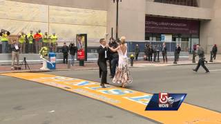video Adrianne Haslet-Davis, wearing a long flowing gown and heels, danced across the finish line with a partner Tuesday morning as part of a commercial campaign. Subscribe to WCVB on YouTube now...