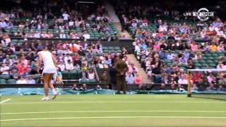 Wimbledon- Caroline Wozniacki hits Jarmila Gajdosova in the warm-up