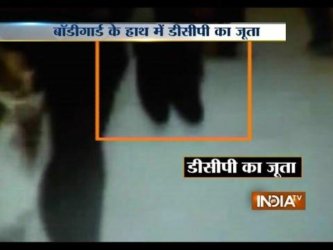 Gujarat Police gunman carries his boss's shoes